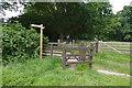 SU9455 : Footpath gates near Pirbright by Alan Hunt
