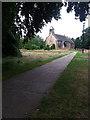 SE2740 : Path through Adel churchyard by Stephen Craven