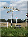 TM0888 : Roadsign & Mile Road sign by Adrian Cable