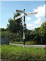 TM0789 : Roadsign on New Buckenham Road by Geographer