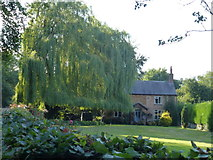 SK8333 : Cottage next to the church in Woolsthorpe By Belvoir by Richard Humphrey