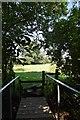 TL6833 : Footbridge and stile by John Myers