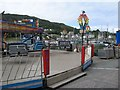 NR8668 : Fairground on the quay by Jonathan Wilkins