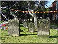 NZ3181 : Headstones in the Graveyard of St Cuthbert's Church by John Lucas