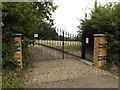 TL9673 : Entrance Gates to St.John's Church Cemetery by Adrian Cable