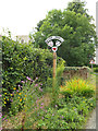 TG1115 : Weston Longville Village sign by Adrian Cable