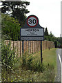 TL9567 : Norton Village Name sign by Adrian Cable