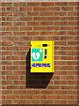TM1494 : Defibrillator on Tacolneston Village Hall by Adrian Cable