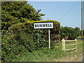TM1292 : Bunwell Village Name sign on the B1113 The Turnpike by Adrian Cable