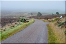 NH5639 : Moorland road on a misty day by Jim Barton