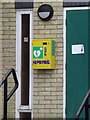 TL9370 : Defibrillator on Ixworth Village Hall by Adrian Cable