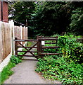 SJ3250 : Wooden gate across a path to Wrexham town centre by Jaggery
