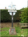 TM1791 : Wacton Village sign by Adrian Cable