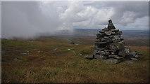 NY6834 : Cairns on Cross Fell by Ian Taylor