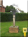 TM1093 : Carleton Rode Village sign by Adrian Cable