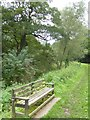 SJ5460 : Memorial seat by Shropshire Union Canal by David Smith