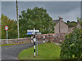 NY6813 : Signpost and bridge, Great Asby by Nigel Brown