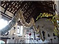 SX4268 : Hanging the Christmas garland in the Great Hall, Cotehele, 2016 by David Smith