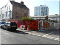 TR3865 : Colourful hoarding, Bellevue Road by John Baker