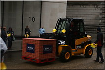 TQ3281 : View of a JCB in the Lord Mayor's Parade from Gresham Street by Robert Lamb