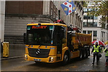 TQ3281 : View of a tipper truck in the Lord Mayor's Parade from Gresham Street by Robert Lamb