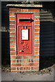 SU8368 : Benchmark on letter box at Plough Lane / London Road junction by Roger Templeman