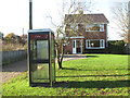 TG1903 : Telephone box at Low Common by Evelyn Simak