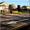ST1672 : White arrows and a bus shelter, Penlan Road, Llandough by Jaggery