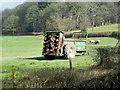 SO0769 : Agricultural Machinery in Field near Cwmfaerdy by David Dixon