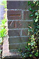 SP7921 : Benchmark on Oving Road bus shelter by Roger Templeman