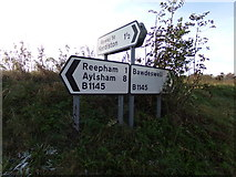 TG0822 : Roadsigns on the B1145 Dereham Road by Geographer