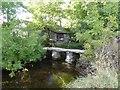 SD9062 : Stone footbridge in Malham by David Smith