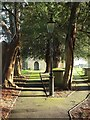 ST7678 : Churchyard paths, Tormarton by Derek Harper