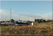 NU1241 : Beached boats and Lindisfarne Priory by Alan Murray-Rust