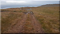 NR5271 : Track across the moor to the estate buildings by Doug Lee
