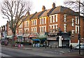 TQ2989 : Parade of shops, Priory Road, Hornsey by Julian Osley