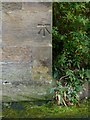 NU1301 : Bench mark, St Mary's Church, Longframlington by Alan Murray-Rust