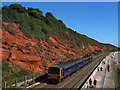 SX9777 : Northbound train on the Dawlish seawall by Stephen Craven