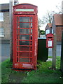 TA0253 : George VI Postbox and telephone box on Church Street, Hutton by JThomas