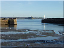 SW4730 : Penzance harbour entrance at low tide by Rod Allday