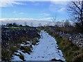 SK2856 : Snowy Longload Lane heading for Duke Street by Ian Calderwood