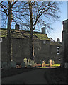 TL3171 : St Ives: a corner of the churchyard by John Sutton