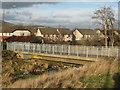 NT3071 : Footbridge over the Niddrie Burn by M J Richardson