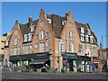 TQ3287 : Manor House and Simply Organique, Seven Sisters Road / Green Lanes, N4 by Mike Quinn