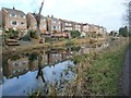 SE4002 : Brampton Crescent houses reflected in the Elsecar Branch by Christine Johnstone