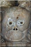 SK7645 : Skull on Burnell Monument by J.Hannan-Briggs