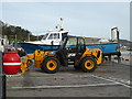 SY3391 : Yellow JCB - Lyme Regis by Chris Allen