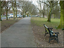 TQ2794 : Path and seat, Oak Hill Park by Robin Webster