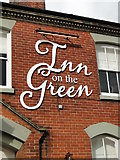 TM0890 : Wall sign for 'Inn on the Green' at New Buckenham by Adrian S Pye