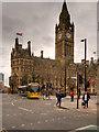 SJ8398 : Metrolink Second City Crossing, Tram Passing Manchester Town Hall by David Dixon